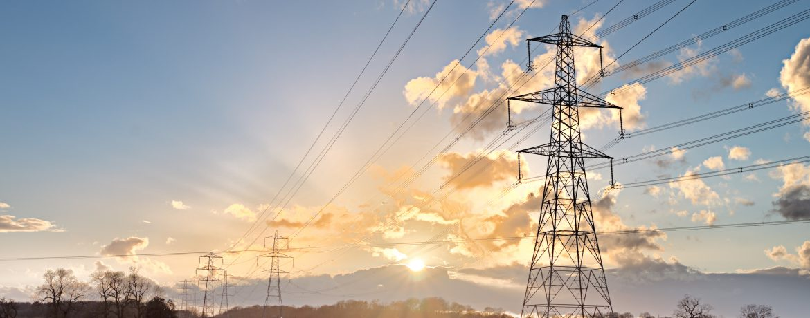 Electricity Pylon - UK standard overhead power line transmission tower at sunset.