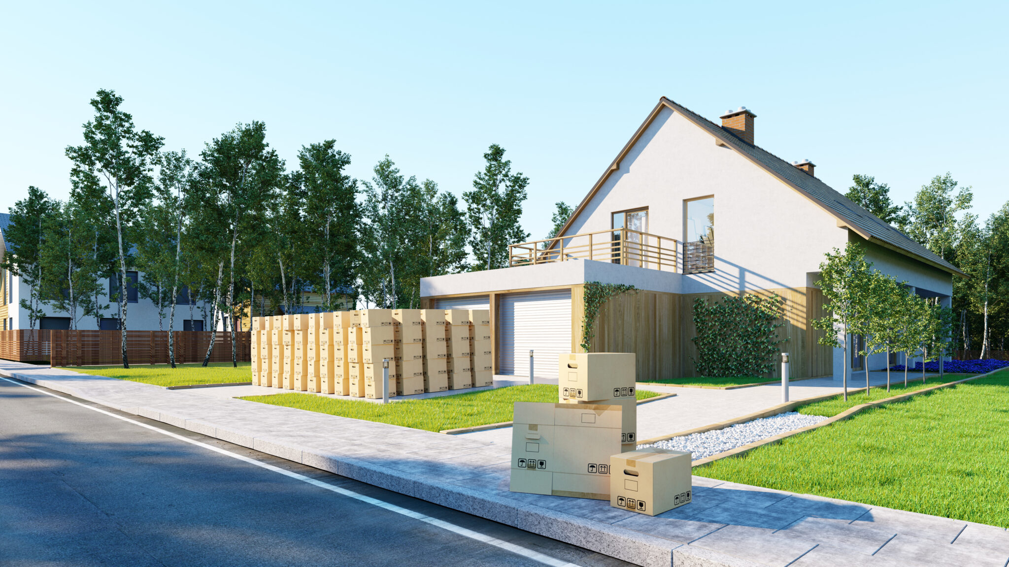 Hausratversicherung bei Umzug ins neue Eigenheim mit vielen Umzugskartons
